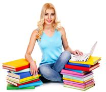 Stock Photo of student with stack book.