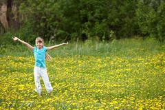 Child on meadow  with hand up. Stock Photos