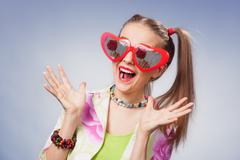 Funny girl with heart glasses Stock Photos