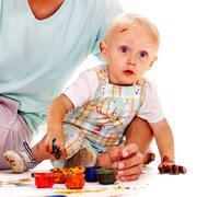 child painting by finger paint. - stock photo