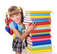 Stock Photo of schoolgirl with backpack holding pile of books.