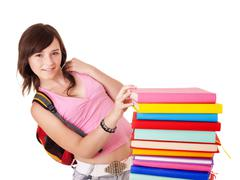Stock Photo of girl with pile colored book .