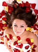 beautiful girl in rose petal. - stock photo