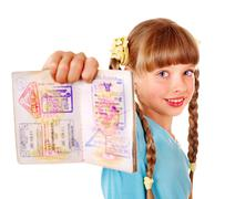 Child holding  passport. foreign vacation. Stock Photos