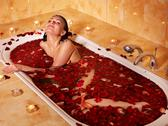 Woman relaxing in bath. Stock Photos