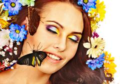Stock Photo of woman with flower and  butterfly.