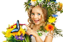 Child with flower hairstyle. Stock Photos
