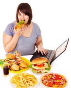 Woman eating junk food. Stock Photos