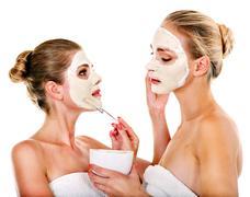 Woman getting facial mask. Stock Photos