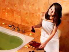 Stock Photo of woman relaxing in bath.