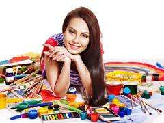artist woman with paint palette. - stock photo