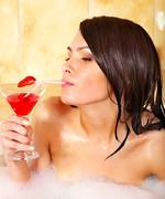woman washing in bubble bath. - stock photo