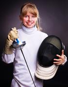 child in fencing costume holding epee  - stock photo