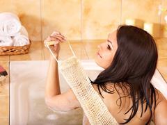 woman take bubble  bath. - stock photo