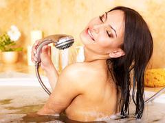Woman take bubble  bath. Stock Photos