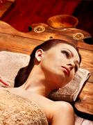 woman having mask at ayurveda spa. - stock photo