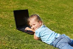 kid with laptop outdoor. - stock photo