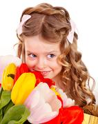 Stock Photo of child with spring flower.