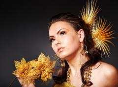 Woman  in carnival costume with flower. Stock Photos