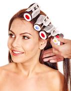 Woman wear hair curlers on head. Stock Photos