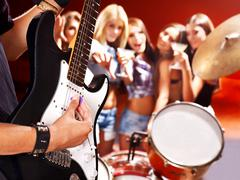 band playing musical  instrument. - stock photo