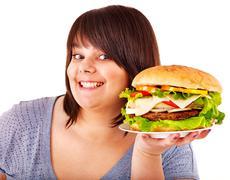 woman eating hamburger. - stock photo