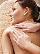 Young woman having classical massage. Stock Photos