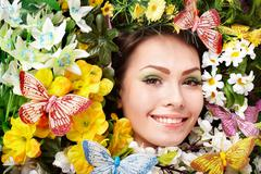 fashion of beautiful girl with butterfly and flower. - stock photo