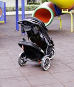 baby carriage in playground - stock photo