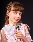 Singing of  girl in microphone. Stock Photos