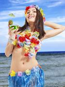 Stock Photo of young woman in  costume of hawaii.