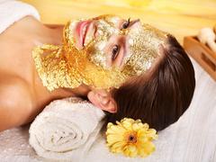 Woman getting  facial mask . Stock Photos