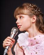 Singing of child in microphone. Stock Photos