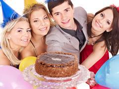 group people holding cake. - stock photo