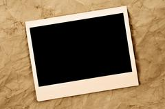 Blank instant photo frame on an old paper background Stock Photos