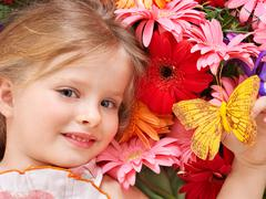 Stock Photo of cute child lying on the flower.