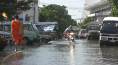 Monk and Motorcycle in a Flooded Road p161 Stock Footage