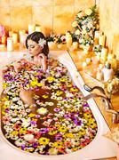 woman applying moisturizer. - stock photo