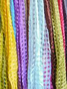 Indian colorful scarf in a row with vivid colors stripes on sell at roadside Stock Photos