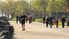 JOGGER AT PARK Stock Footage