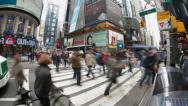 Stock Video Footage of Crowd of people walking at busy intersection time-lapse