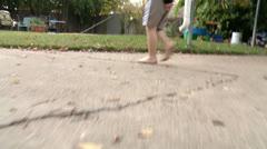 Kids Feet Walking Camera Follows-PhotoJpeg - stock footage