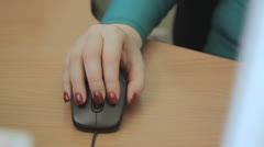 girl's hand working black mouse on table - stock footage