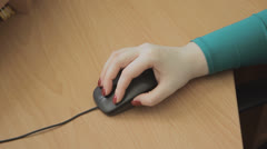 Girl's hand working black mouse on table Stock Footage