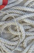 sailing ropes with dash of red - stock photo