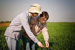 women in wheat field - stock photo