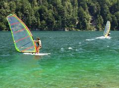 windsurfers in a mountain lake - stock photo