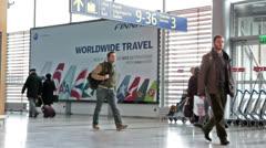 Boarding hall with passengers in Helsinki Vaanta Airport Stock Footage