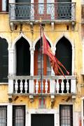 venice: 14th century palace with balcony and the city's flag, near rialto and - stock photo