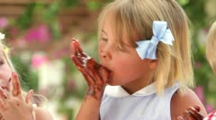 Girl Licking Melted Chocolate From Fingers Stock Footage